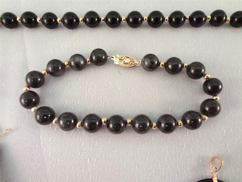 14K Gold Black Jade Jewelry Suite: (1) Necklace, (4) Pendants, (2) Bracelets, (1) Ring