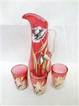 Hand Blown Cranberry Glass Pitcher Enamel Flowers and (3) Tumblers