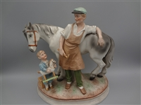 German Bisque Figural Group Farmer With Boy